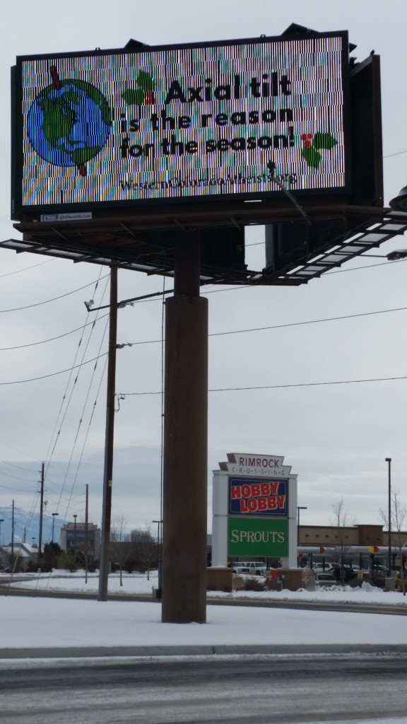 WCAF's billboard celebrating the winter solstice season, 2015, located near Hobby Lobby ahd Chick-Fil-A on I-70 Business loop